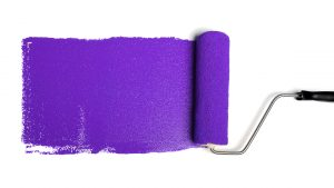 photo of a paint roller with purple paint
