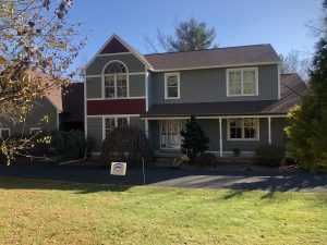 exterior photo of a house in Shrewsbury MA painted by Aurora Exterior Painting